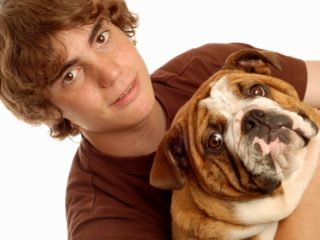 3228864 - attractive fourteen year old boy and his pet bulldog puppy