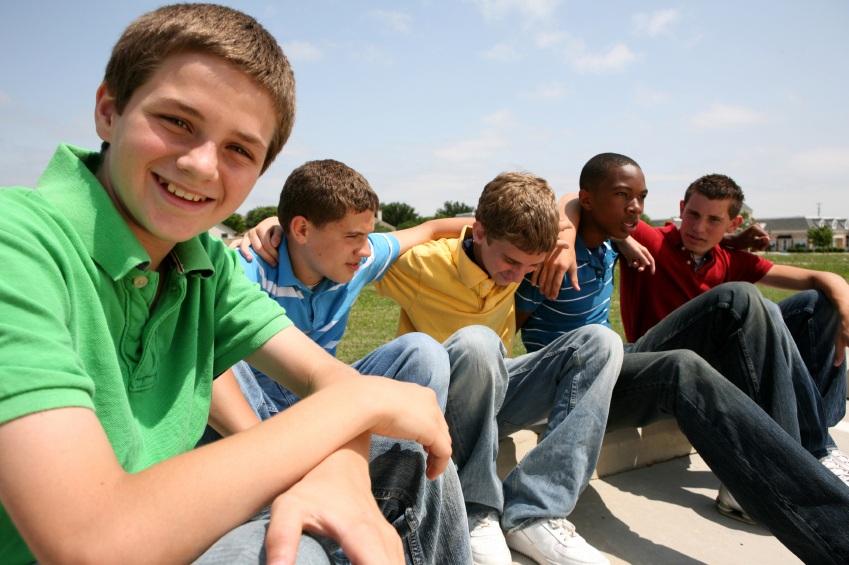 stock-photo-6004289-group-of-teenage-boys-sitting-in-the-sun_medium